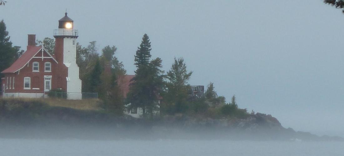 lighthouse and fog
